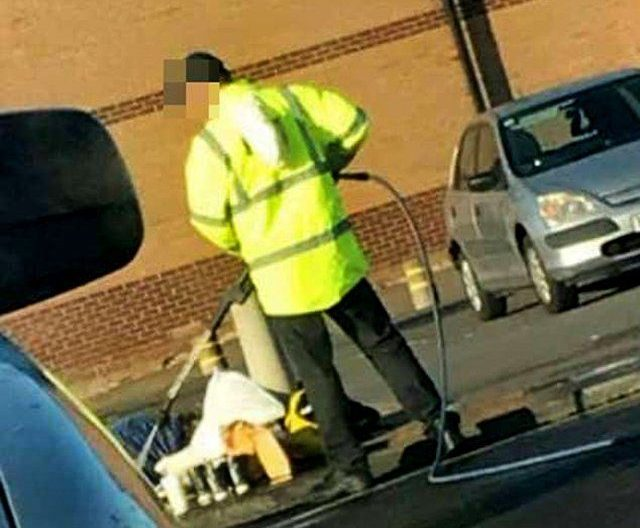 McDonald's worker filmed spraying homeless man with jet washer Picture: keereganxx snapchat SOURCE NOT FOUND RIPPED FROM MAIL ONLINE