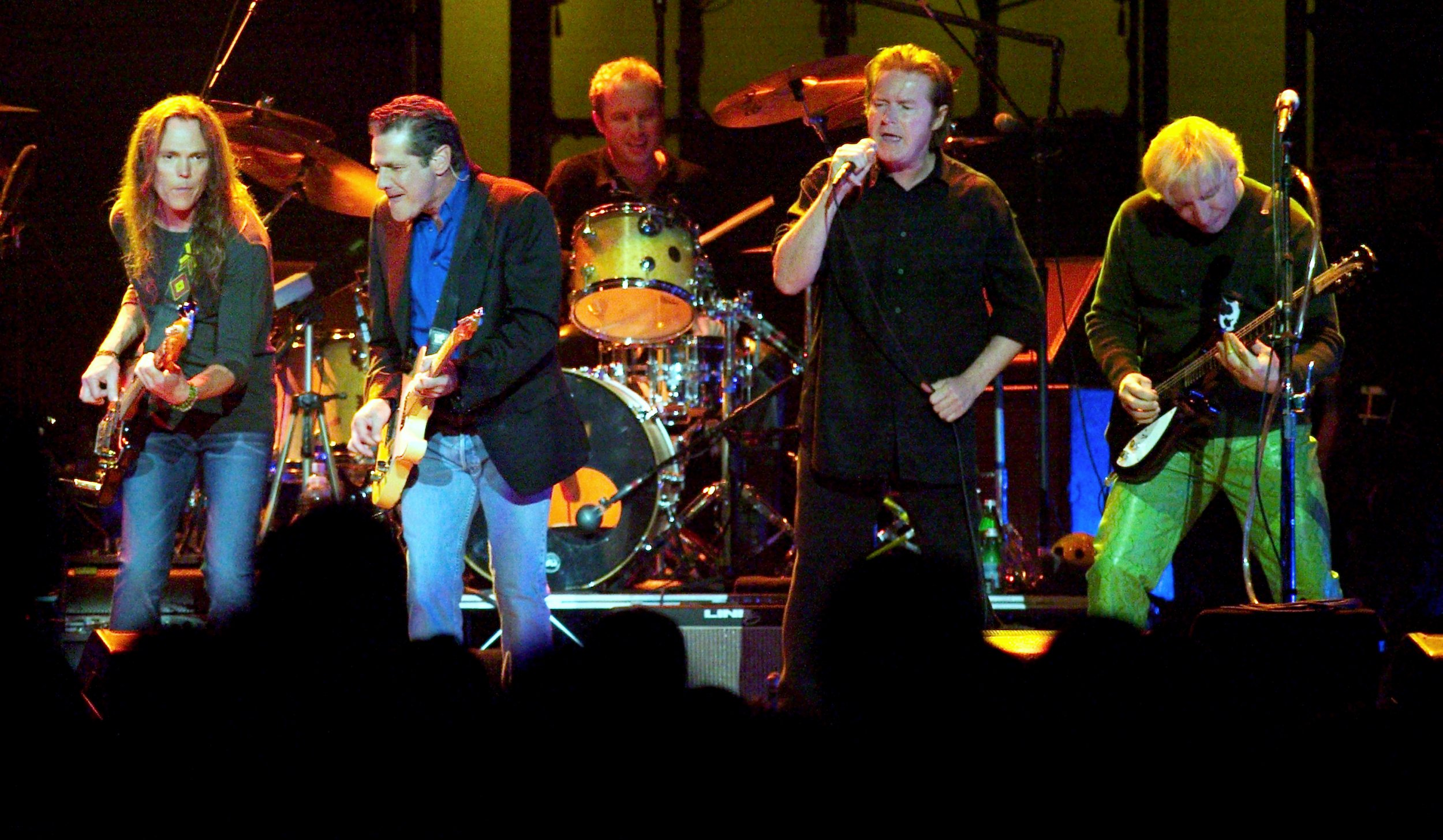 "The Eagles (L-R) Timothy B. Schmit, Glenn Frey, Don Henley and Joe Walsh, perform the song ""The Long Run"" during a sold-out show on the band's ""Farewell I"" tour at the MGM Grand Garden Arena in Las Vegas, Nevada, August 9, 2003. REUTERS/Ethan Miller EM/GAC - RP4DRHYCZGAB"