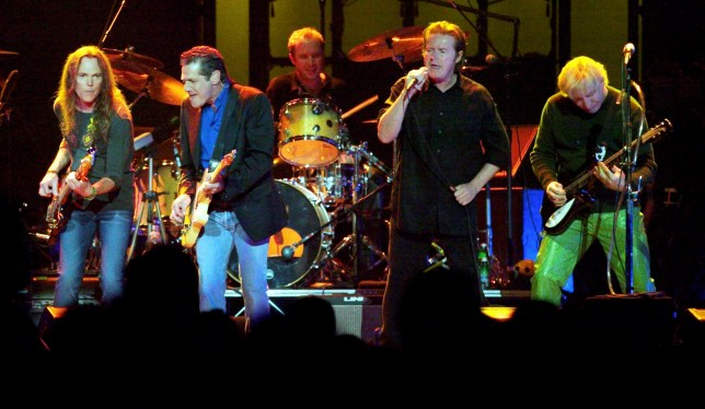 """The Eagles (L-R) Timothy B. Schmit, Glenn Frey, Don Henley and Joe Walsh, perform the song """"The Long Run"""" during a sold-out show on the band's """"Farewell I"""" tour at the MGM Grand Garden Arena in Las Vegas, Nevada, August 9, 2003. REUTERS/Ethan Miller EM/GAC - RP4DRHYCZGAB"""