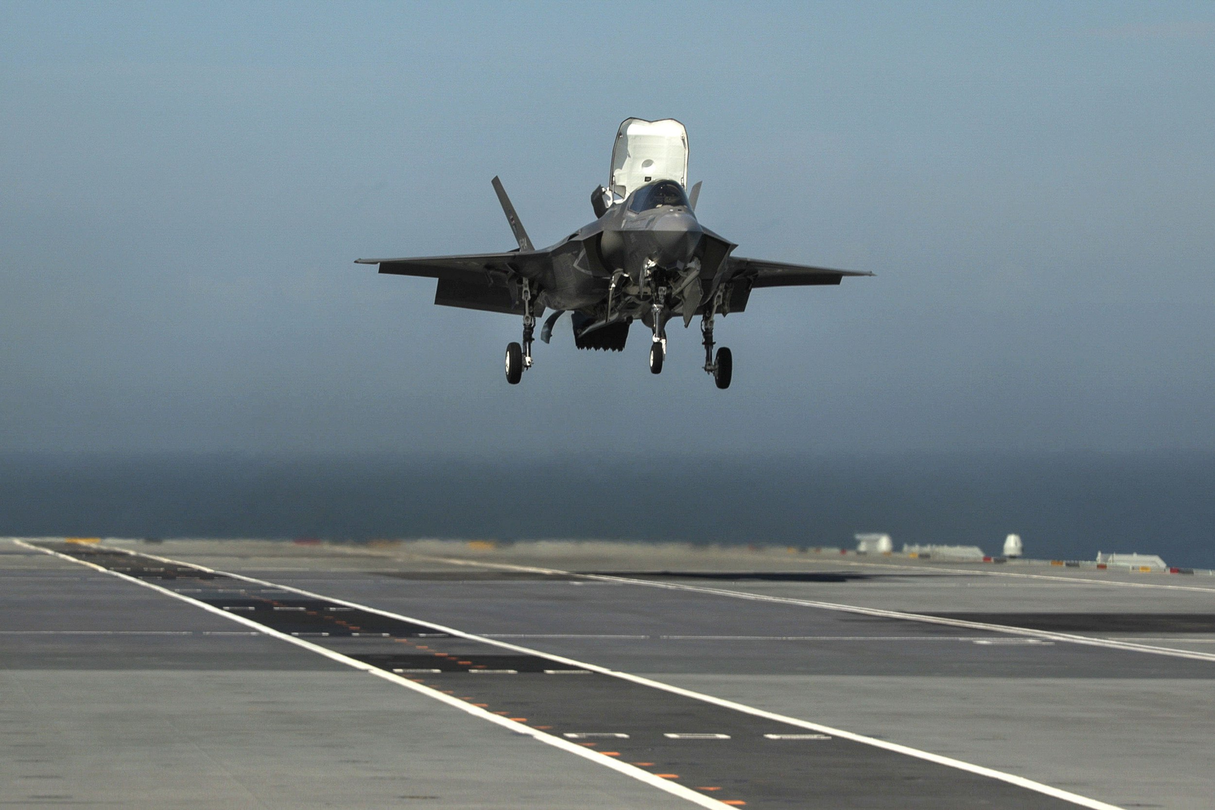 Embargoed to 2200 Friday September 28 Ministry of Defence handout photo dated 25/09/18 of Royal Navy Commander Nathan Gray making one of the first ever F-35B Lightning II jet vertical landings on the UK's new aircraft carrier HMS Queen Elizabeth. PRESS ASSOCIATION Photo. Issue date: Friday September 28, 2018. See PA story POLITICS Carrier. Photo credit should read: PO Arron Hoare/Royal Navy/MoD/Crown copyright/PA Wire NOTE TO EDITORS: This handout photo may only be used in for editorial reporting purposes for the contemporaneous illustration of events, things or the people in the image or facts mentioned in the caption. Reuse of the picture may require further permission from the copyright holder.