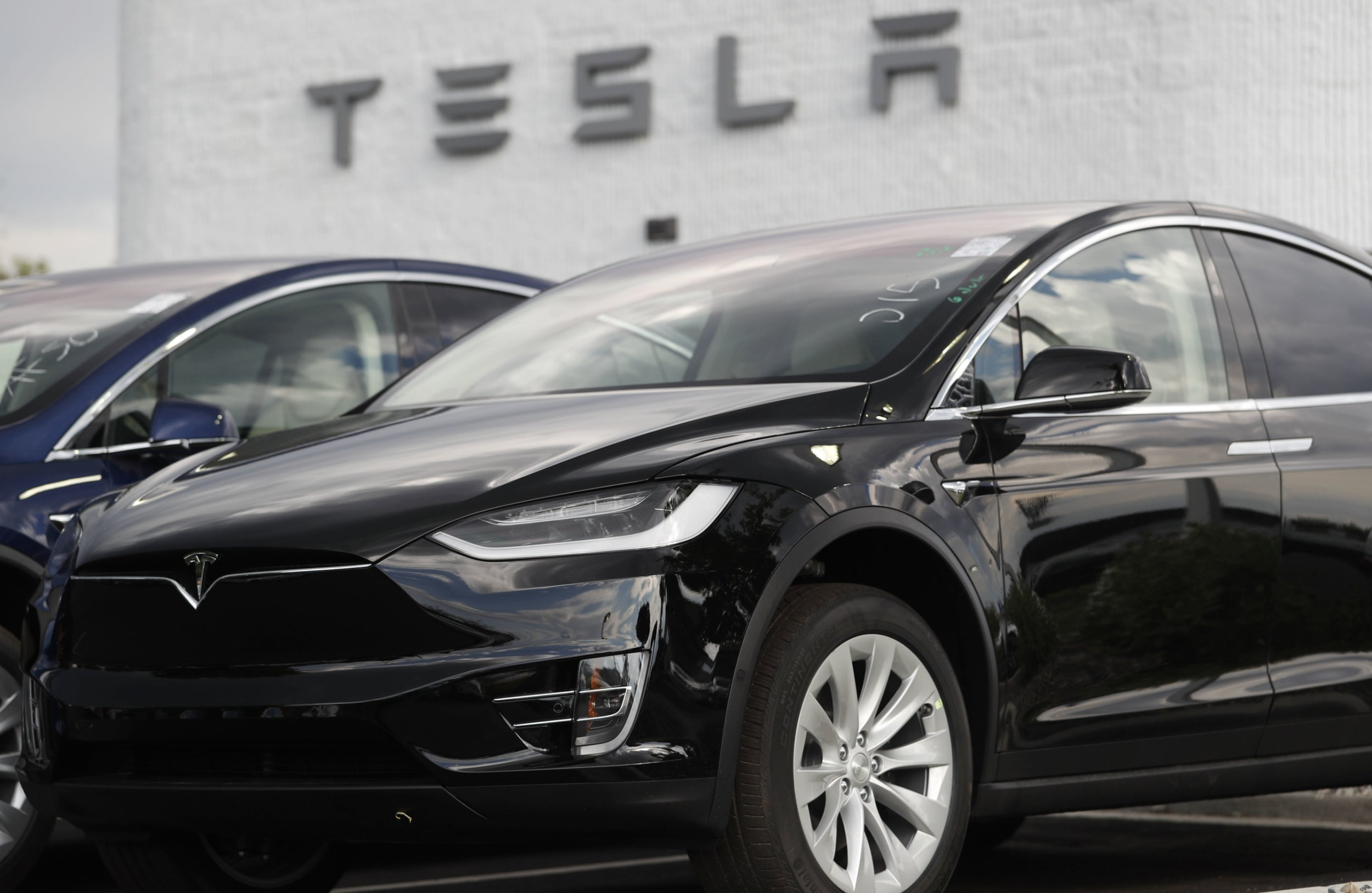 FILE - In this July 8, 2018 file photo, a 2018 Model X sits on display outside a Tesla showroom in Littleton, Colo. Elon Musk???s murky future as Tesla Motors??? CEO amid a securities fraud lawsuit isn???t the only cloud hanging over the electric car maker. The company was on shaky financial ground even before government regulators set out to remove Musk, a blow that has increased the pressure on Tesla to prove it can consistently manufacture enough cars to survive. (AP Photo/David Zalubowski, File)