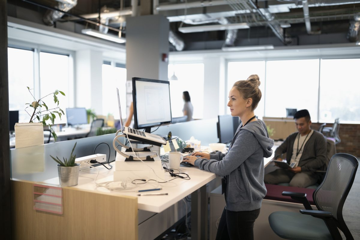 Standing desks might boost work performance, so there's a reason for your boss to get you one
