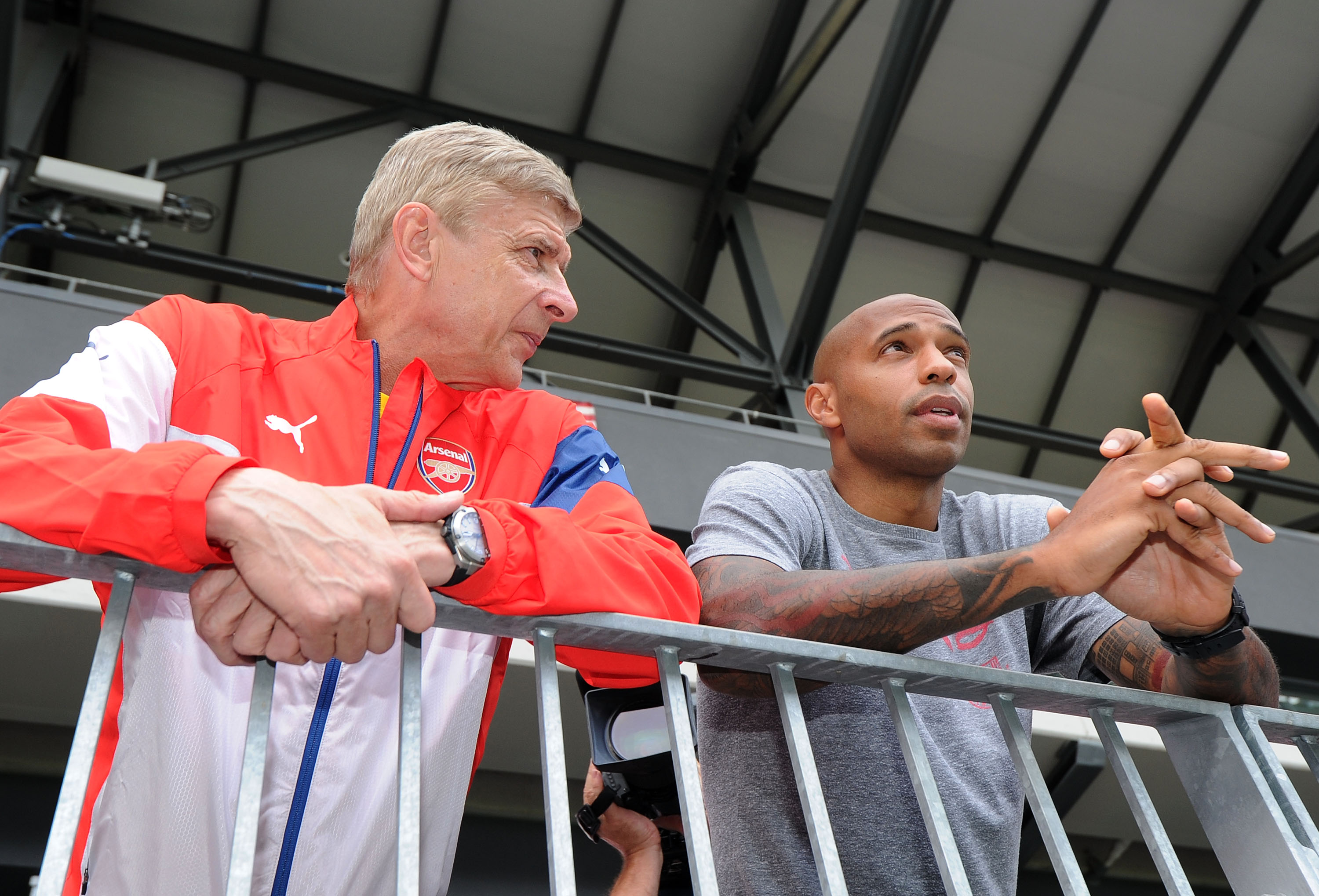 Arsene Wenger gives advice to Thierry Henry after taking charge of Monaco