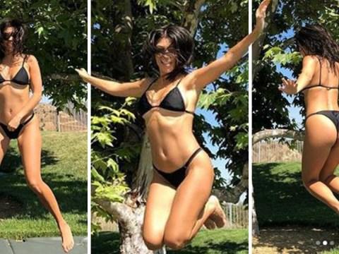 Kourtney Kardashian jumps for joy as she ignores sister Kim Kardashian's 'least exciting' comments