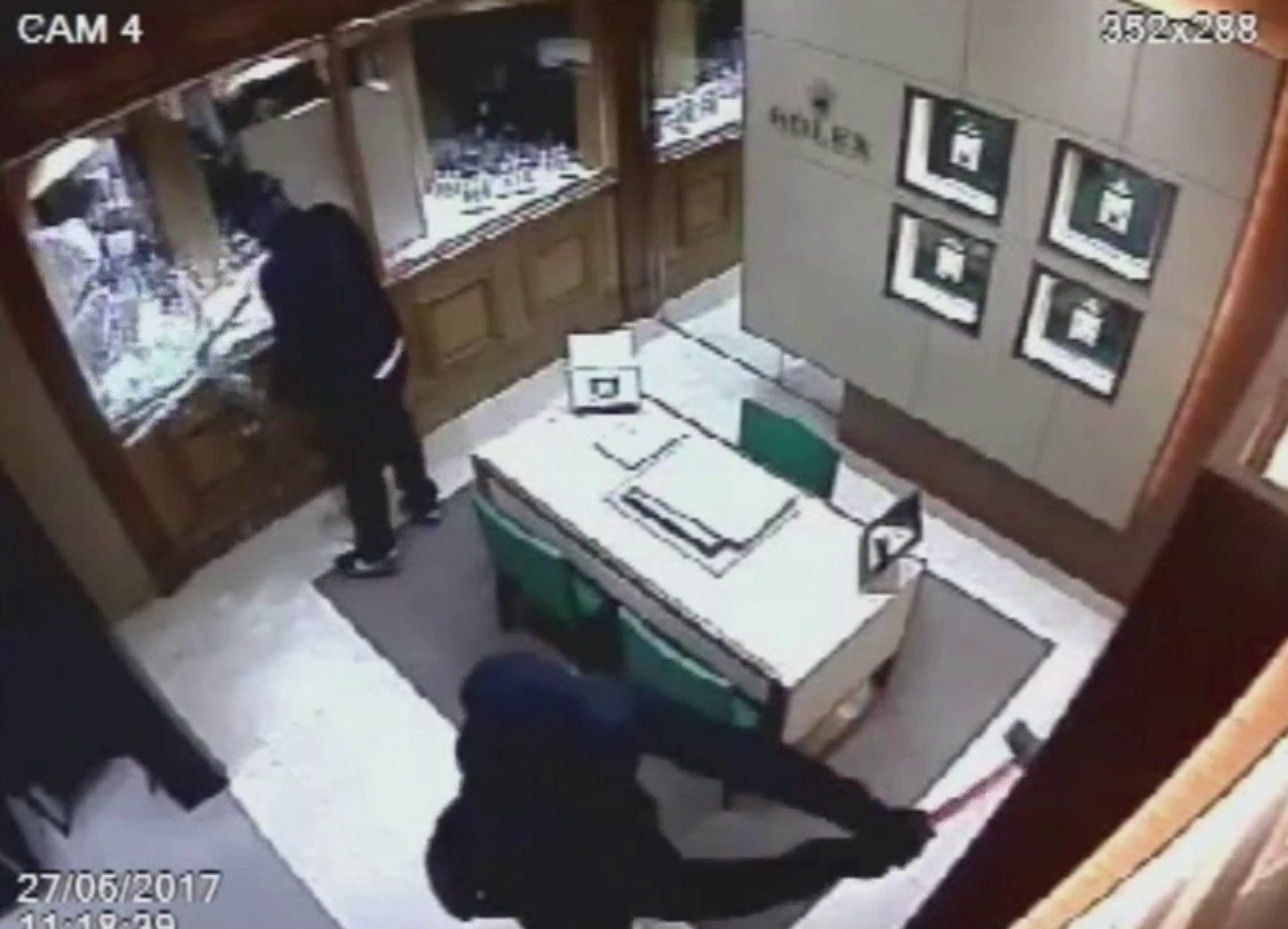 """CCTV footage from inside the Mappin and Webb jewellers at Gleneagles Hotel during the armed robbery. A man has been convicted of a ?500,000 armed jewellery heist at Gleneagles Hotel. Richard Fleming, 42, used hammers, a pistol and a machete during the raid last June. A jury at the High Court in Edinburgh found Fleming, from London, guilty of assault and armed robbery at the five-star Perthshire resort. Another man - Liam Richardson, 30, admitted his involvement in the robbery at an earlier hearing. Fleming and Richardson were part of a three-man team that stole 50 Rolex watches from the Mappin & Webb boutique at the luxury hotel. Jurors heard staff members say that the trio were dressed in black. Fleming personally threatened employees Louis Hutchison, 48, and Euan Wishart, 36, with a gun, a machete and hammers. After a raid that last approximately two minutes, Fleming and his accomplices escaped from the scene in a high-powered Audi sports car, which they dumped nearby. They had taken 50 out of 51 Rolex watches that were on display at the boutique. The watches had a total value of ?516,750 and have never been recovered. The robbers then drove to Glasgow in a Range Rover Evoque, which had been stolen earlier from London. It was later found burned out in a cemetery in the city's east end. After finding the car, detectives analysed """"tens of thousands of hours"""" worth of CCTV recordings and studied mobile phone records, which placed Fleming and Richardson at the crime scene."""