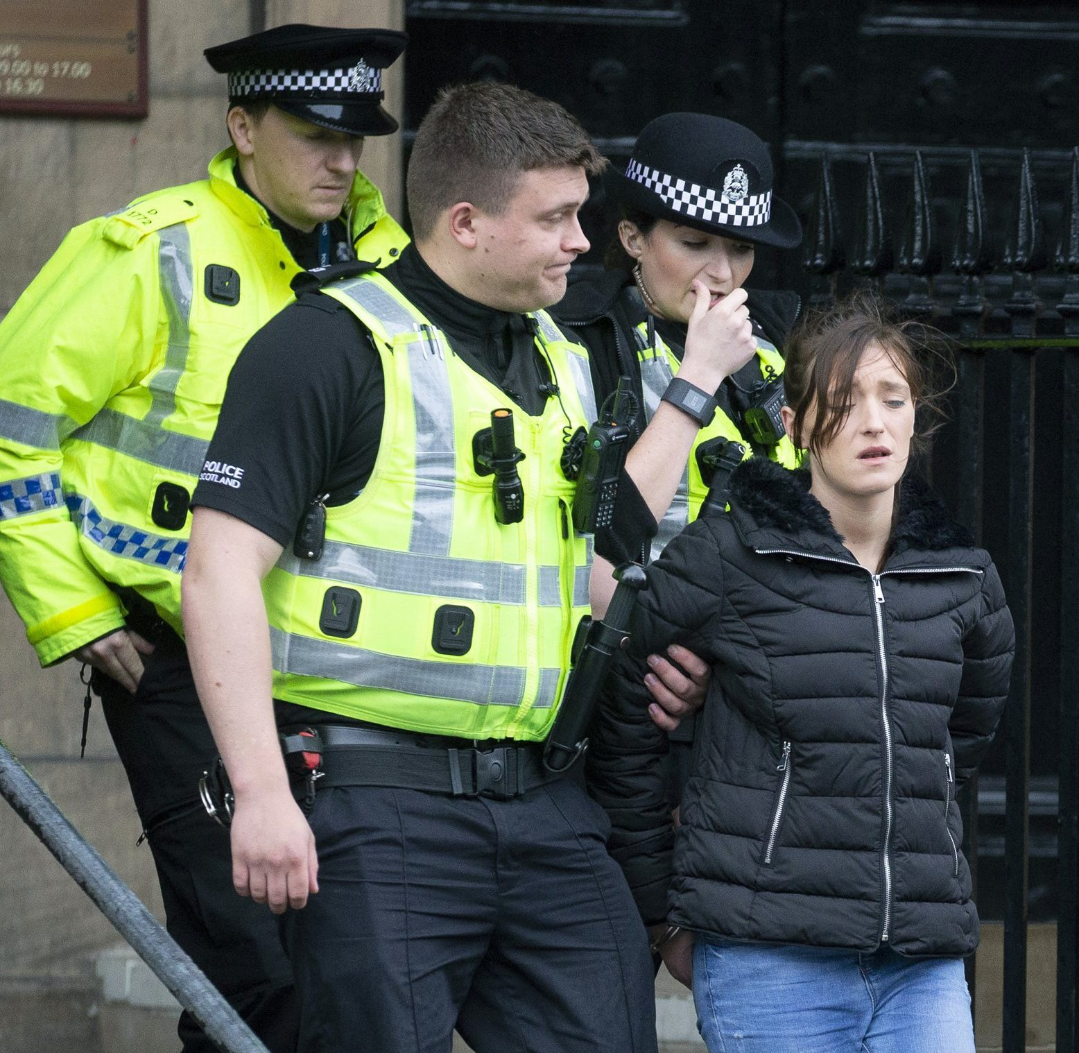 Perth Sheriff Court???..19.09.18 *****NO BYELINE PLEASE***** Darlene Mullen is led from court after being arrested for stealing a jacket from Primark whilst on her way to attending court. see story by Gordon Currie Picture by Graeme Hart. Copyright Perthshire Picture Agency Tel: 01738 623350 Mobile: 07990 594431