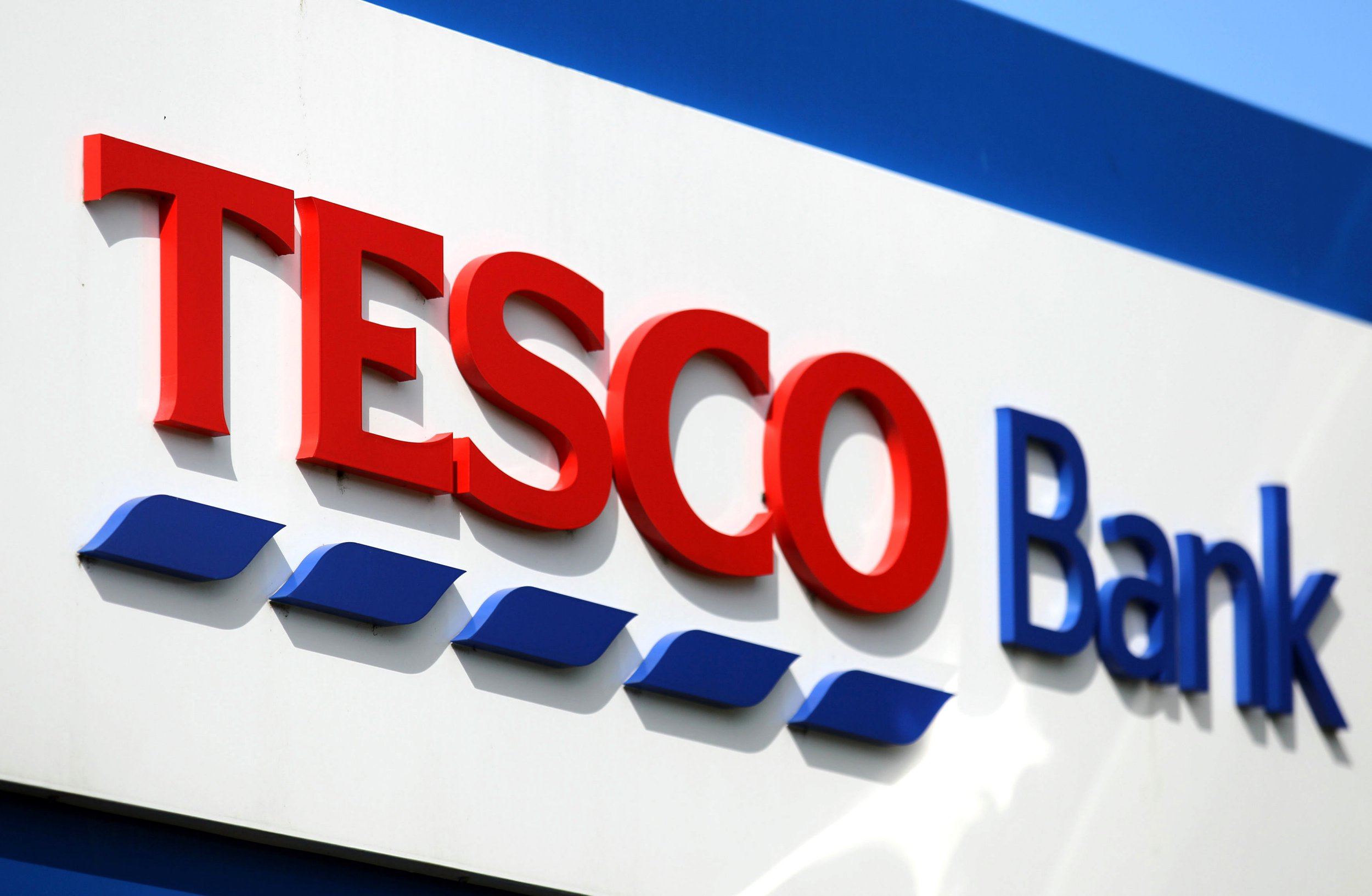 File photo dated 10/06/14 of a Tesco Bank sign, as the company has agreed to pay ?16.4 million as part of a settlement with the Financial Conduct Authority following a cyber attack in 2016. PRESS ASSOCIATION Photo. Issue date: Monday October 1, 2018. See PA story CITY Tesco. Photo credit should read: Andrew Milligan/PA Wire