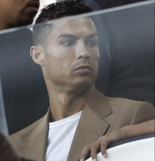 "FILE - In this Tuesday, Oct. 2, 2018 file photo, Juventus forward Cristiano Ronaldo sits in the stands during a Champions League, group H soccer match between Juventus and Young Boys, at the Allianz stadium in Turin, Italy. Lawyers for a Nevada woman who has accused Cristiano Ronaldo of raping her say a psychiatrist determined she suffers post-traumatic stress and depression because of the alleged 2009 attack in Las Vegas. Kathryn Mayorga's attorney, Leslie Stovall, told reporters Wednesday that the psychiatrist's medical opinion is that Mayorga's psychological injuries made her ""incompetent"" to legally reach a non-disclosure settlement with Ronaldo's representatives in 2010. (AP Photo/Luca Bruno, File )"