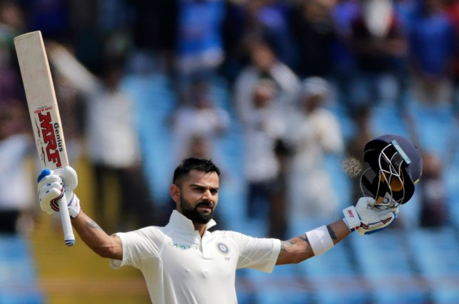 Indian cricketer Virat Kohli celebrates his century during the second day of the first cricket test match between India and West Indies in Rajkot, India, Friday, Oct. 5, 2018. (AP Photo/Rajanish Kakade)