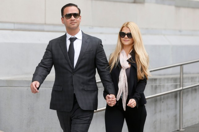 "Michael ""The Situation"" Sorrentino leaves federal court with his fiancee Lauren Pesce after his sentencing in Newark, N.J., on Friday, Oct. 5, 2018. Sorrentino pleaded guilty to tax evasion in January, and was sentenced Friday to eight months in prison. (Aristide Economopoulos/NJ Advance Media via AP)"