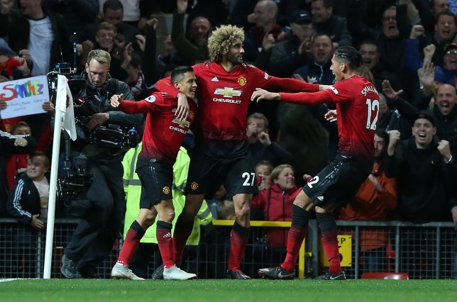 epa07074753 Manchester United's Alexis Sanchez (L) celebrates scoring with teamates during the English Premier League soccer match between Manchester United and Newcastle United at the Old Trafford Stadium in Manchester, Britain, 06 October 2018. EPA/NIGEL RODDIS EDITORIAL USE ONLY. No use with unauthorized audio, video, data, fixture lists, club/league logos or 'live' services. Online in-match use limited to 120 images, no video emulation. No use in betting, games or single club/league/player publications.