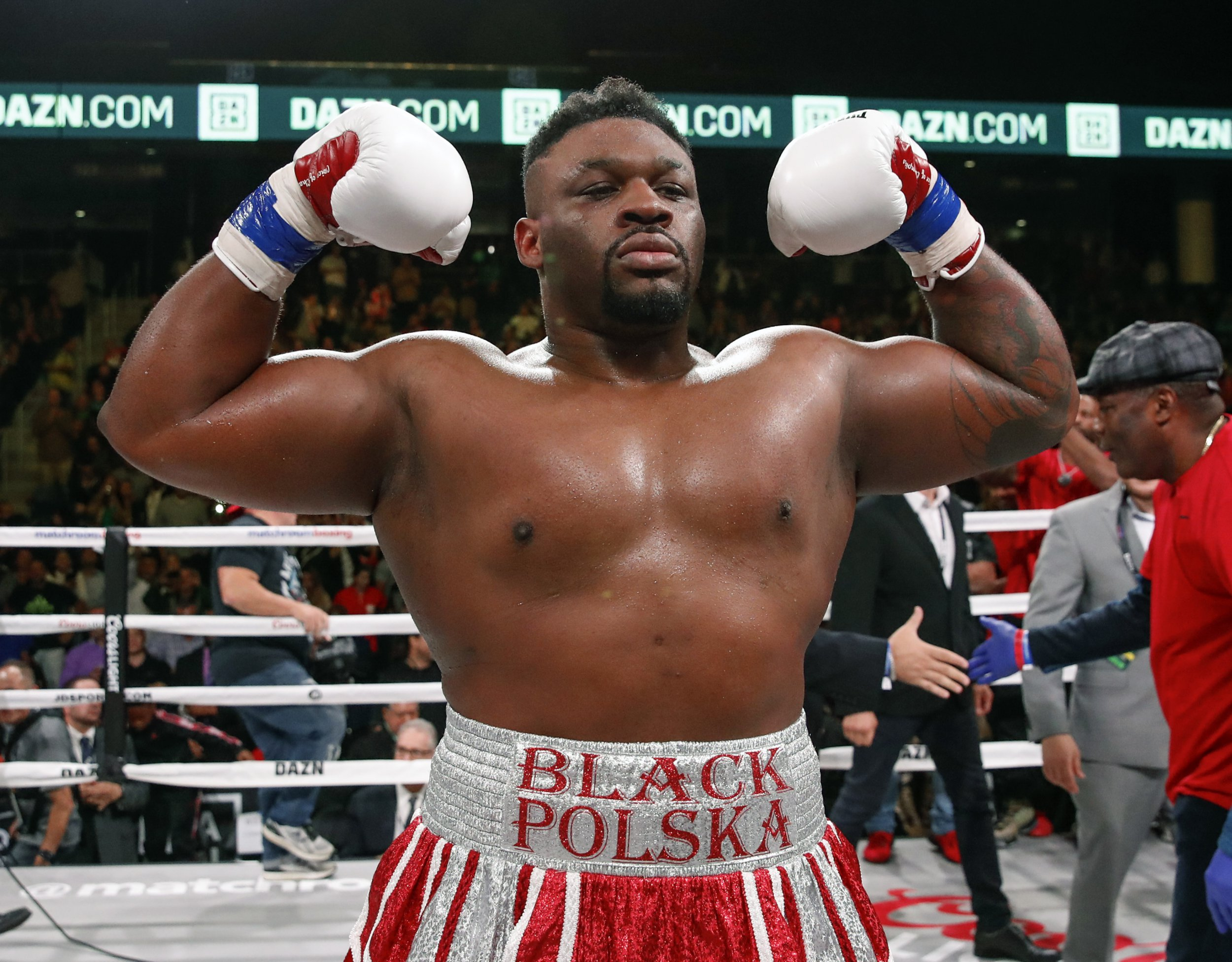 Jarrell Miller celebrates after defeating Tomasz Adamek, of Poland, during a heavyweight boxing match Saturday, Oct. 6, 2018, in Chicago. (AP Photo/Kamil Krzaczynski)