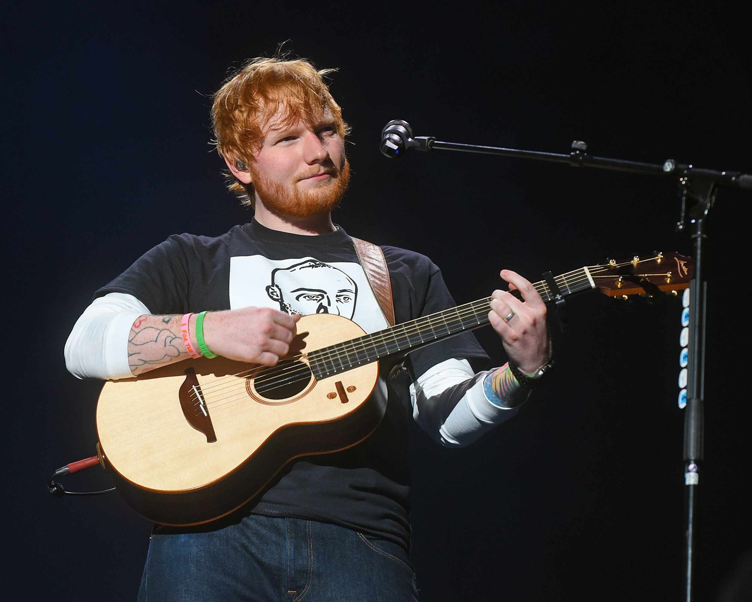 Mandatory Credit: Photo by Action Press/REX/Shutterstock (9907716f) Ed Sheeran Ed Sheeran in concert, Pittsburgh, USA - 29 Sep 2018 Ed Sheeran pays tribute to Pittsburgh rapper Mac Miller by wearing a t-shirt depicting his face.