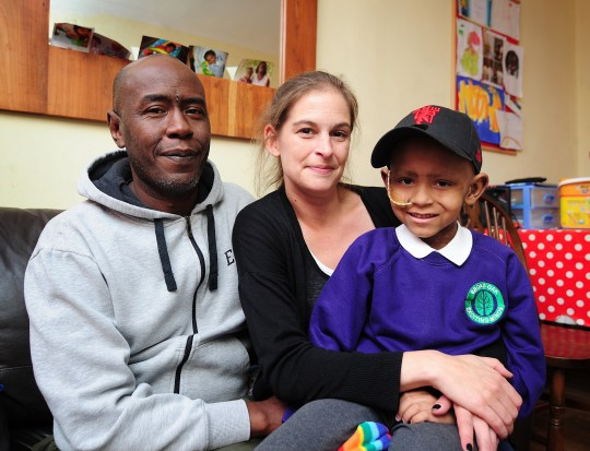 When six-year-old Blaise Nelson was diagnosed with a brain tumour, his devastated mum and dad dropped everything to look after him. Rachel and Chris Nelson, who both work as freelancers, immediately quit work so they could care for him. caption: Chris and Rachel Nelson with son Blaise
