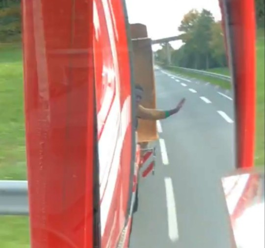 """Images from public Facebook - trying to contact Ryan Ledgister SHOCKING video shows a British lorry driver give suspected immigrants a terrifying open-air motorway """"lesson"""" after warning them not to get on board. Footage shows two men clamber on to the transporter and later wave at the driver to slow down as speeds along the motorway. The driver can be heard saying: """"I told you I wasn't stopping. You're going to Holland."""" The videos were posted to the Facebook account of Ryan Ledgister, who wrote: ?I told these motherf****** I?m not stupid enough to stop here on my way home, don?t waste your time, and they didn?t listen. """"Boy you going to learn today?. The post has been shared over 18,000 times, and many people have branded Ryan as a ?legend?."""