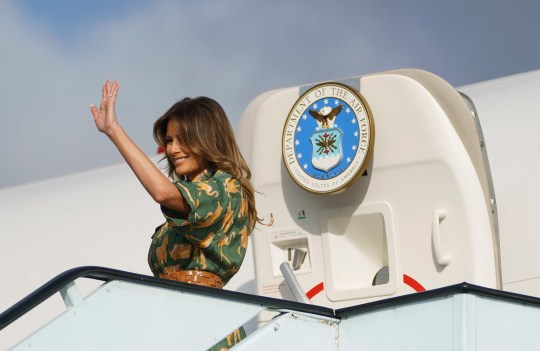 First lady Melania Trump waves as she boards a plane at Jomo Kenyatta International Airport in Nairobi, Kenya, Saturday, Oct. 6, 2018. First lady Melania Trump is visiting Africa on her first big solo international trip. (AP Photo/Carolyn Kaster)