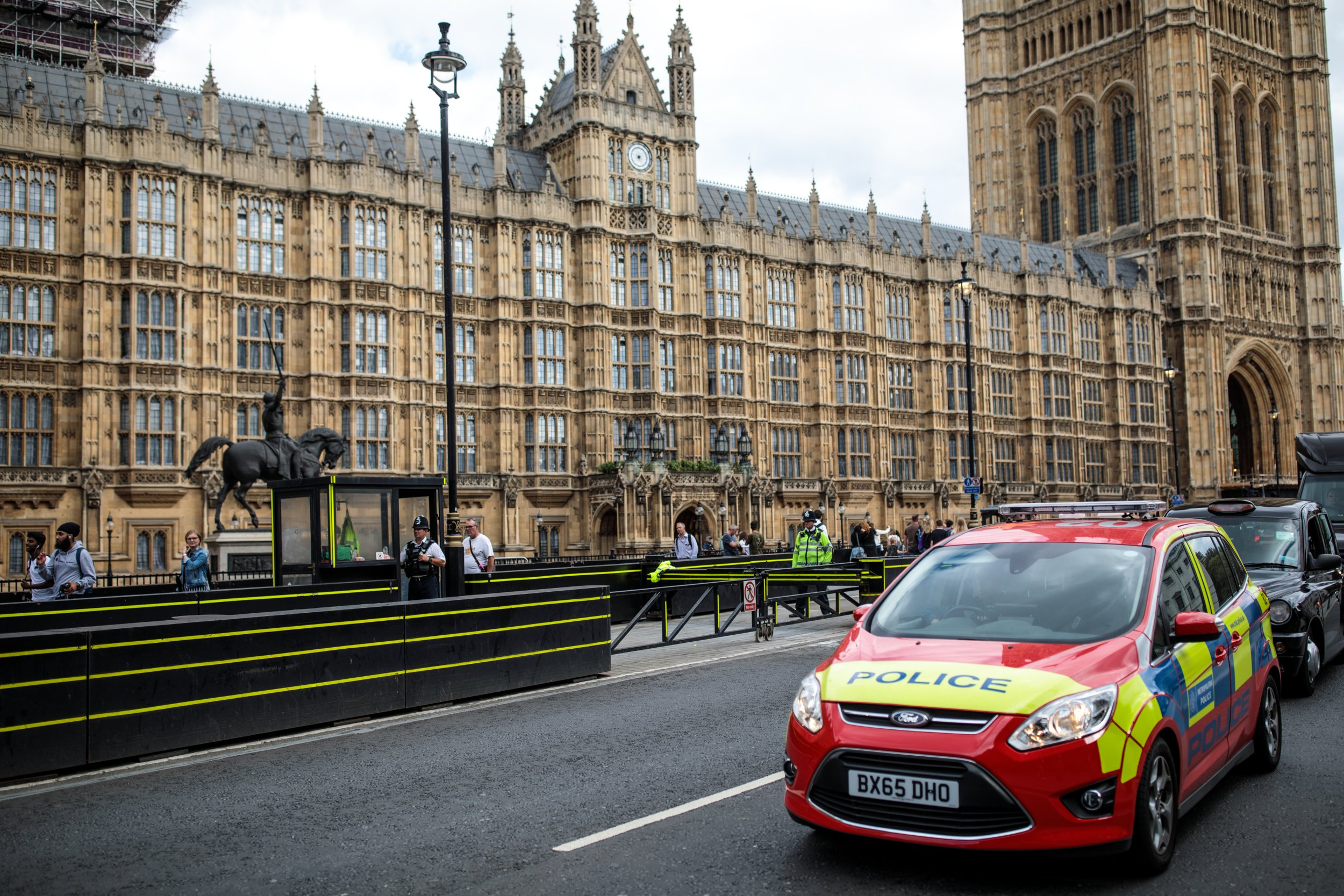 LONDON, ENGLAND - AUGUST 15: A police car drives past the Houses of Parliament following yesterday morning's incident, which is being investigated by terror police on August 15, 2018 in London, England. 29-year-old Salih Khater was named by police today as the man arrested on suspicion of terror offences after he crashed his car outside the Houses of Parliament injuring cyclists and pedestrians. (Photo by Jack Taylor/Getty Images)