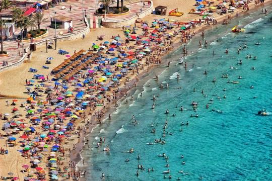 Crowded beach in Calp, Valencia, Spain.