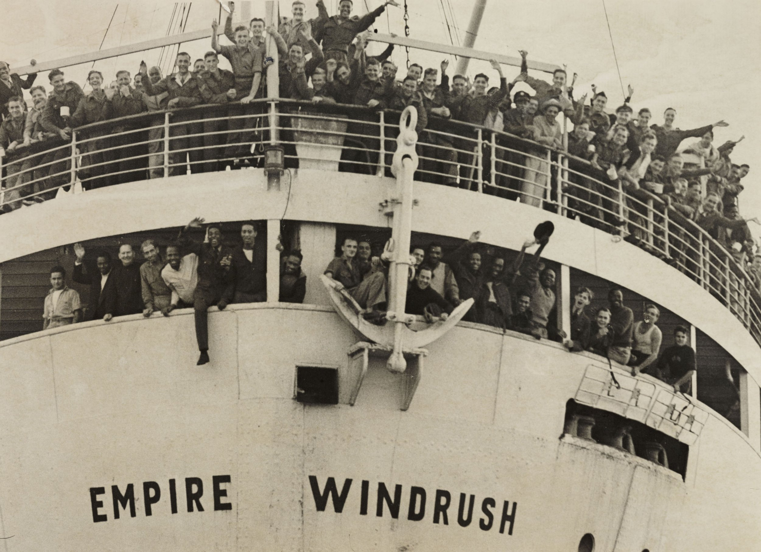 UNITED KINGDOM - JUNE 02: The 'Empire Windrush' arriving from Jamaica, 1948. A photograph of the 'Empire Windrush' at Tilbury docks, having sailed from Australia via Jamaica, taken by Jones for the Daily Herald newspaper on 21 June, 1948. During the war, thousands of men and women from the Caribbean had served in the armed forces. When the 'Empire Windrush' stopped in Jamaica to pick up servicemen, many people, having seen the 'Daily Gleaner' newspaper advertising the journey for ??28.10, decided to travel to Britain. On 24 May the ship left Kingston, Jamaica with nearly 500 passengers. It docked at Tilbury on 21 June 1948. This photograph has been selected from the Daily Herald Archive, a collection of over three million photographs. The archive holds work of international, national and local importance by both staff and agency photographers. (Photo by Daily Herald Archive/SSPL/Getty Images)