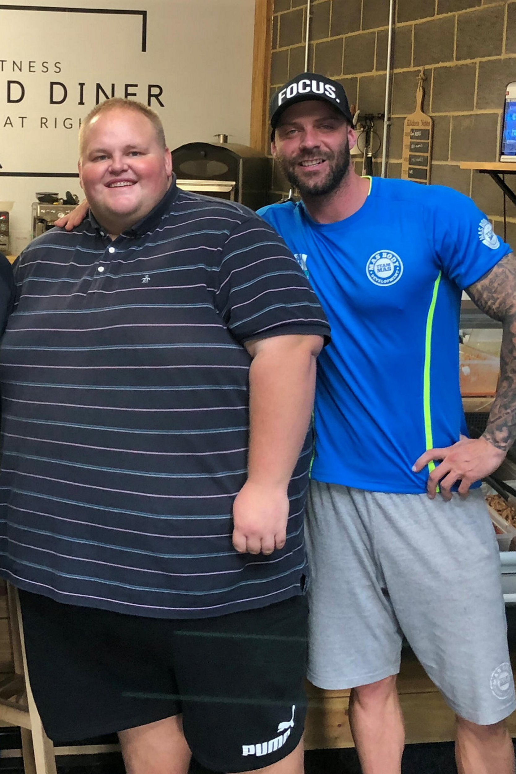 "Darren McClintock, 27 (L) with trainer, Mike Hind (R). Takeaways have been warned not to serve a morbidly obese man after doctors told him ""you're eating yourself to death"". See SWNS story SWLEFAT. Darren McClintock, 27, was eating pasties, chips and pies daily before being given the urgent wake up call when he was hospitalised with heart problems. Darren, known as 'Dibsy', has now embarked on a healthy new lifestyle with the help of award-winning personal trainer Mike Hind. The two of them have have gone around their hometown of Middlesbrough handing out posters to all Dibsy's favourite restaurants saying ""do not serve this man"". At the moment Dibsy has to book two seats on planes and order specially sized clothing that costs extra. He was served the wake up call after being admitted to hospital because his heart was beating too fast, when he says he could have died."