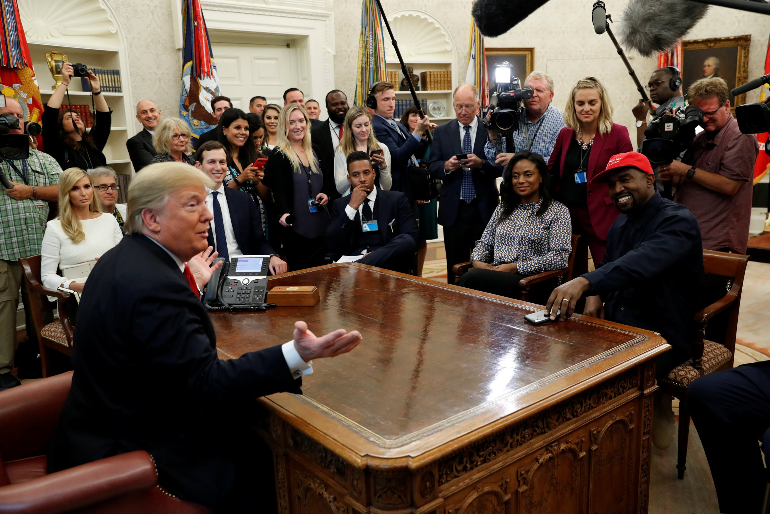 U.S. President Donald Trump speaks during a meeting with rapper Kanye West in the Oval Office at the White House in Washington, U.S., October 11, 2018. REUTERS/Kevin Lamarque