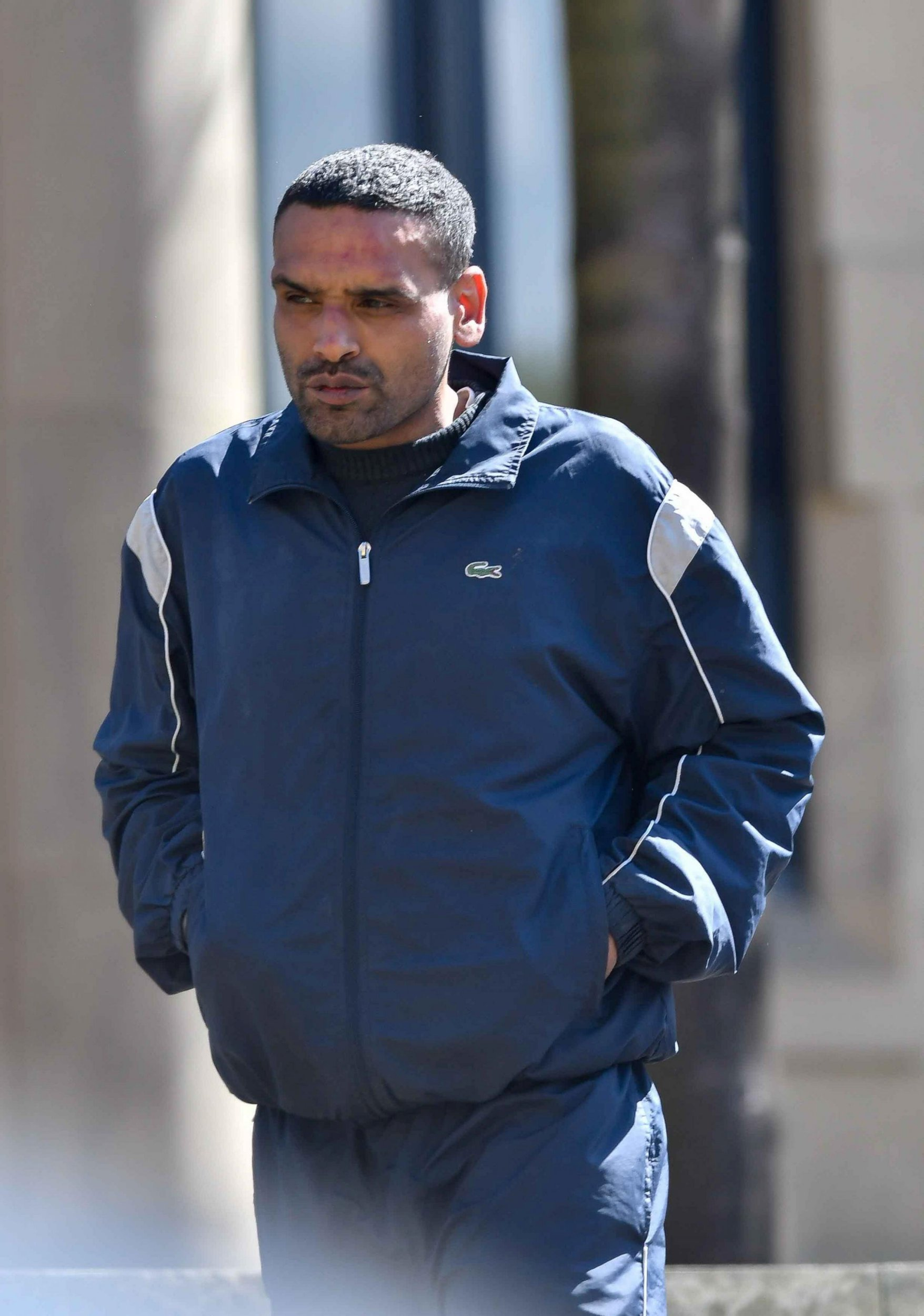 Defendant Shaid Hanif leaves Bradford Crown court. See SWNS story SWLErape; Shaid Hanif from Bradford found guilty of raping a young woman he picked up outside a club - who already had a broken jaw. During the trial, the court heard that Hanif came across the woman by chance outside Jurys Inn, Bradford. Her shirt was covered in blood, she had no handbag and she had suffered a broken jaw, chipped teeth, a fractured finger and bruising and grazing.