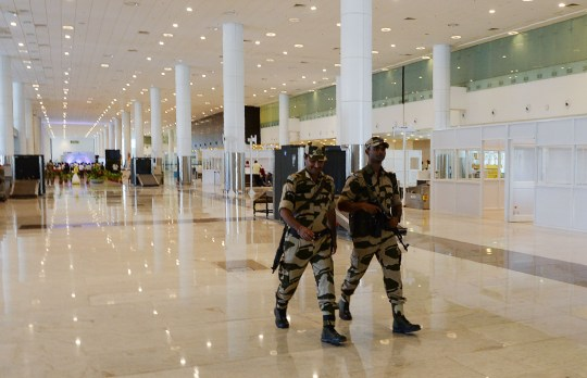 Armed Central Industrial Security Force (CISF) patrol at a new international arrival terminal, developed under an airport modernisation programme in Chennai on September 28, 2018. (Photo by ARUN SANKAR / AFP) (Photo credit should read ARUN SANKAR/AFP/Getty Images)