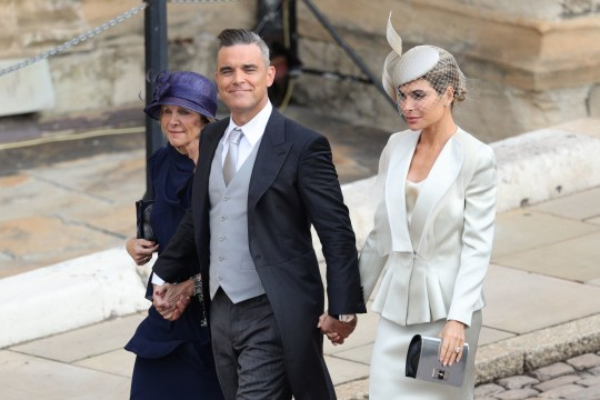 Robbie Williams and Ayda Field (right) arrive for the wedding of Princess Eugenie to Jack Brooksbank at St George's Chapel in Windsor Castle. PRESS ASSOCIATION Photo. Picture date: Friday October 12, 2018. See PA story ROYAL Wedding. Photo credit should read: Aaron Chown/PA Wire