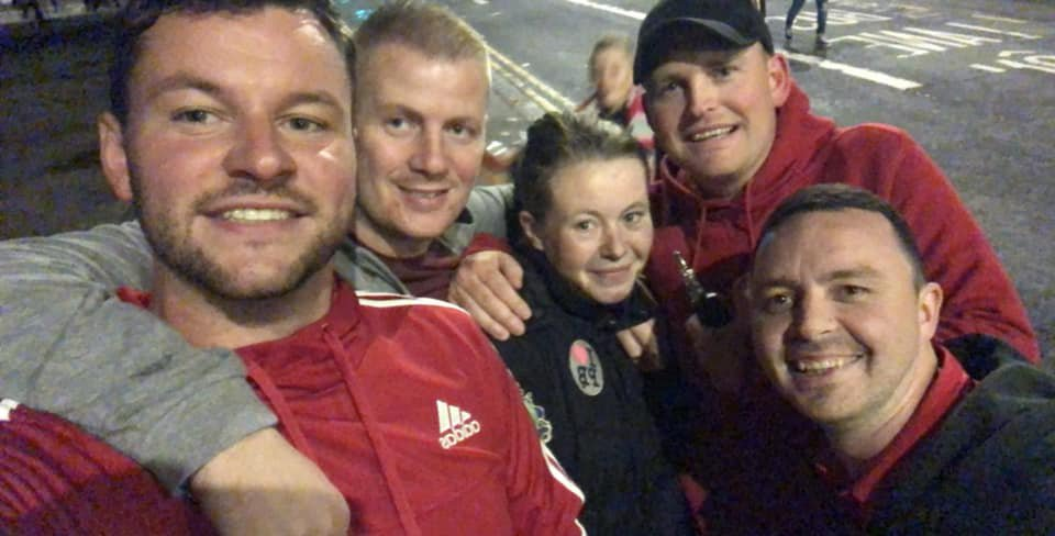 """Five big-hearted soccer fans with a spare ticket to a big game gave it to a homeless woman - and also treated her to a meal and hotel for the night. Kind-hearted Lloyd Jones and his mates were enjoying a pre-match drink when a friend rang to say he couldn't make it to Wales v Spain game. So the pair spotted a young homeless woman called Samantha sitting on a mattress outside - and asked her: """"Do you want to join us?"""" Pictured here enjoying the experience is Samantha and the 5 lads (Lloyd Jones on the left). ? WALES NEWS SERVICE"""