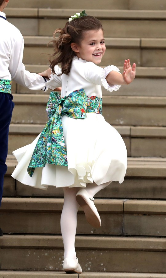 Bridesmaid Theodora Williams, daughter of Robbie Williams and Ayda Field, waves a she arrives to attend the wedding of Britain's Princess Eugenie of York to Jack Brooksbank at St George's Chapel, Windsor Castle, in Windsor, on October 12, 2018. (Photo by Steve Parsons / POOL / AFP)STEVE PARSONS/AFP/Getty Images