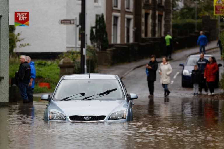Pictured: A car is stranded outside the River View restaurant on the flooded Dulais Fach Road (B4434) between the areas of Aberdulais and Tonna in Neath, south Wales, UK. Saturday 13 October 2018 Re: Flooding caused by Storm Callum in the Neath area, south Wales, UK.