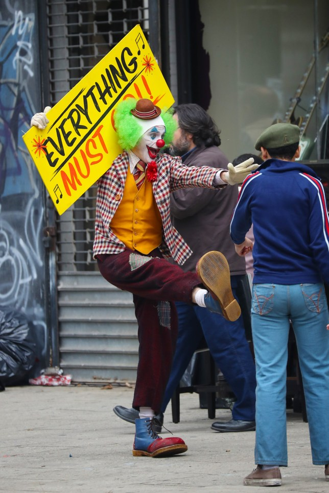 10/13/2018 EXCLUSIVE: Joaquin Phoenix films the Joker in New York City. The 43 year old actor was spotted dancing on the street fully decked out as the DC super-villain. While promoting a tag sale for a nearby store the joker is attacked by some kids who steal his sign resulting in him chasing after the group. sales@theimagedirect.com Please byline:TheImageDirect.com *EXCLUSIVE PLEASE EMAIL sales@theimagedirect.com FOR FEES BEFORE USE