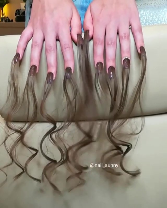 These Rapunzel manicures are the creepiest thing you'll see this week Picture: nail_sunny https://www.instagram.com/p/BohZJADHFIV/?hl=en&taken-by=nail_sunny
