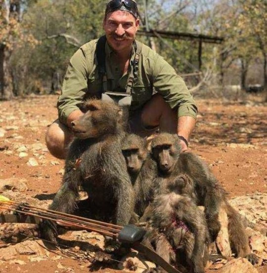 Boasting baboon killer Credit: Idaho's Office of the Governor