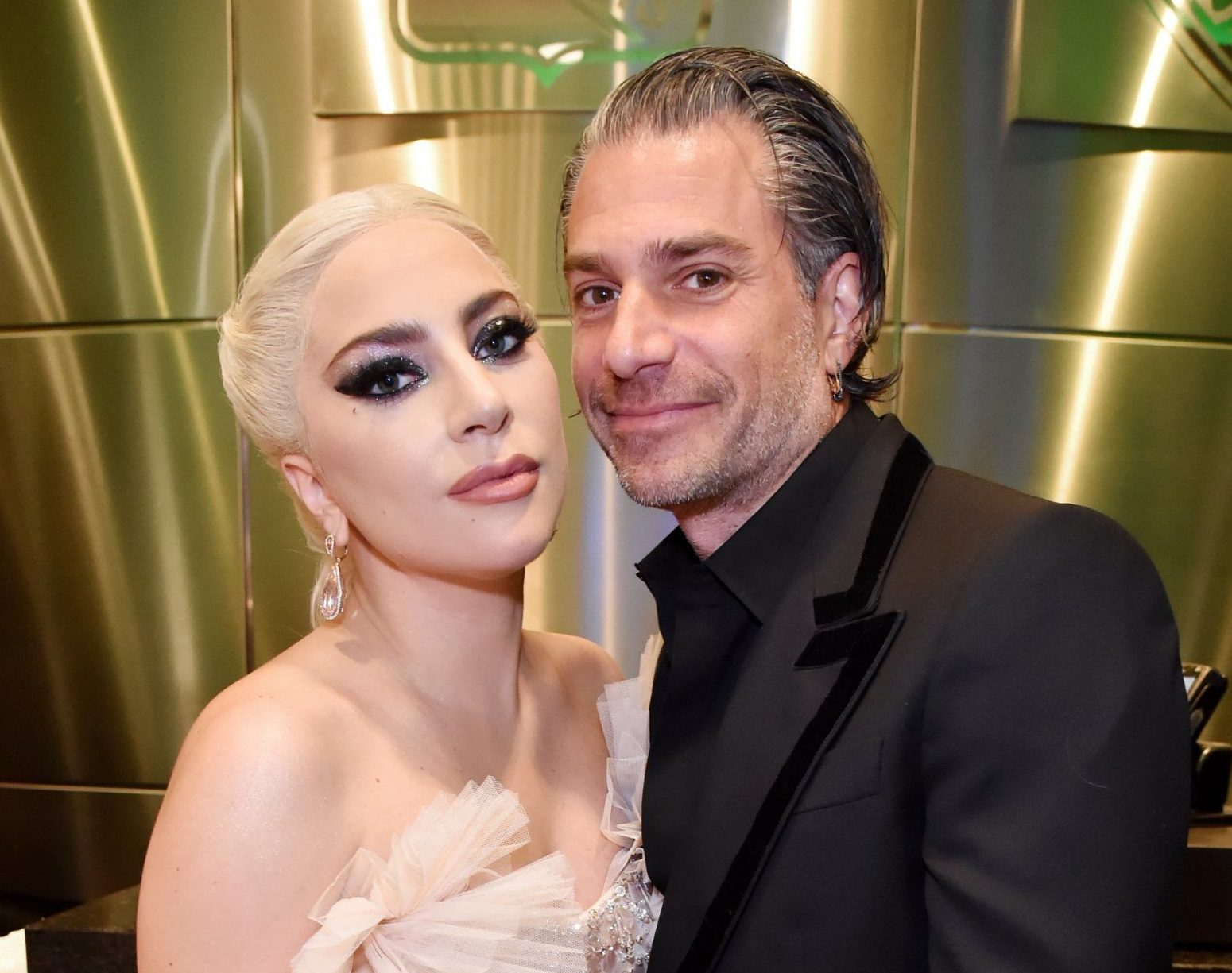 FILE - Lady Gaga Confirms Engagement To Christian Carino At Women In Hollywood Awards NEW YORK, NY - JANUARY 28: Recording artist Lady Gaga and agent Christian Carino embrace backstage at the 60th Annual GRAMMY Awards at Madison Square Garden on January 28, 2018 in New York City. (Photo by Kevin Mazur/Getty Images for NARAS)