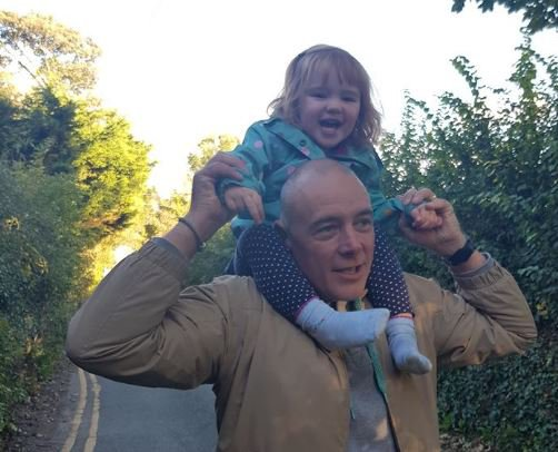 A toddler was forced to poo in the car park of a library after she was refused access to the toilet. Dad Brett Hewitt-Hallam had taken his two-year-old daughter Matilda to Glossop Library on Saturday afternoon when the incident happened. caption: Brett Hewitt-Hallam with daughter Matilda