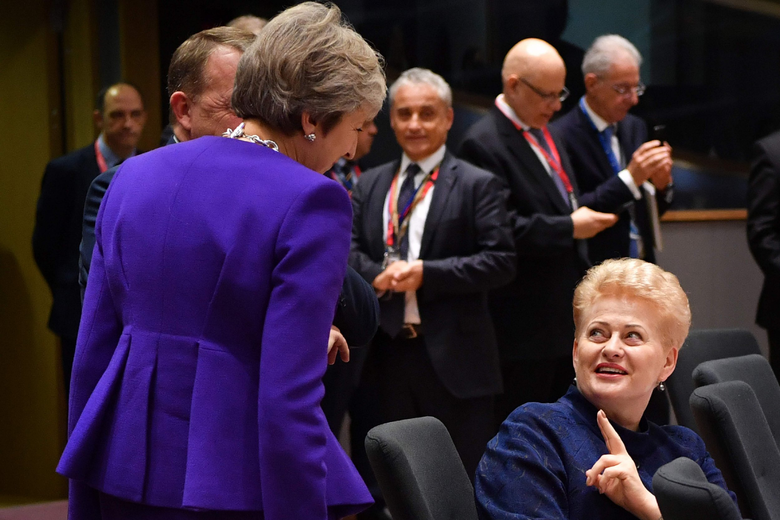 Lithuania's President Dalia Grybauskaite (R) gestures as she speaks to Britain Prime Minister Theresa May (L) during the second day of a European Union leaders summit at the European Council in Brussels on October 18, 2018. - European Union leaders meet for a summit focused on migration and internal security, after reviewing the state of the Brexit negotiations with Britain. (Photo by BEN STANSALL / AFP)BEN STANSALL/AFP/Getty Images