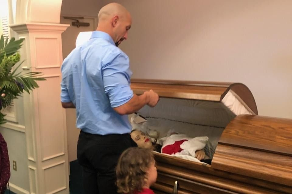 Husband opens coffins showing wife and child to show result of drink driving METRO GRAB taken from: https://www.gofundme.com/63m2cgw Credit: Zach Kincaid/GoFundMe