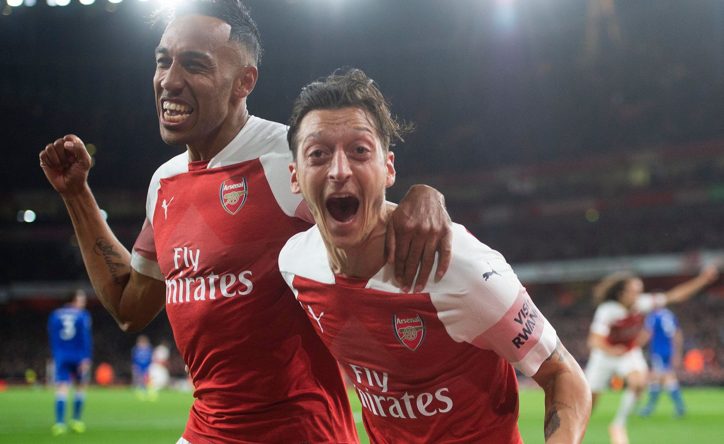 LONDON, ENGLAND - OCTOBER 22: Pierre-Emerick Aubameyang celebrates scoring Arsenal's 3rd goal with Mesut Ozil during the Premier League match between Arsenal FC and Leicester City at Emirates Stadium on October 22, 2018 in London, United Kingdom. (Photo by David Price/Arsenal FC via Getty Images)