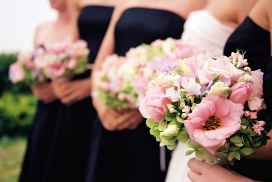 Bridesmaids with flowers - foreground only in focus. Beautiful Springtime bouquets in pink and green.