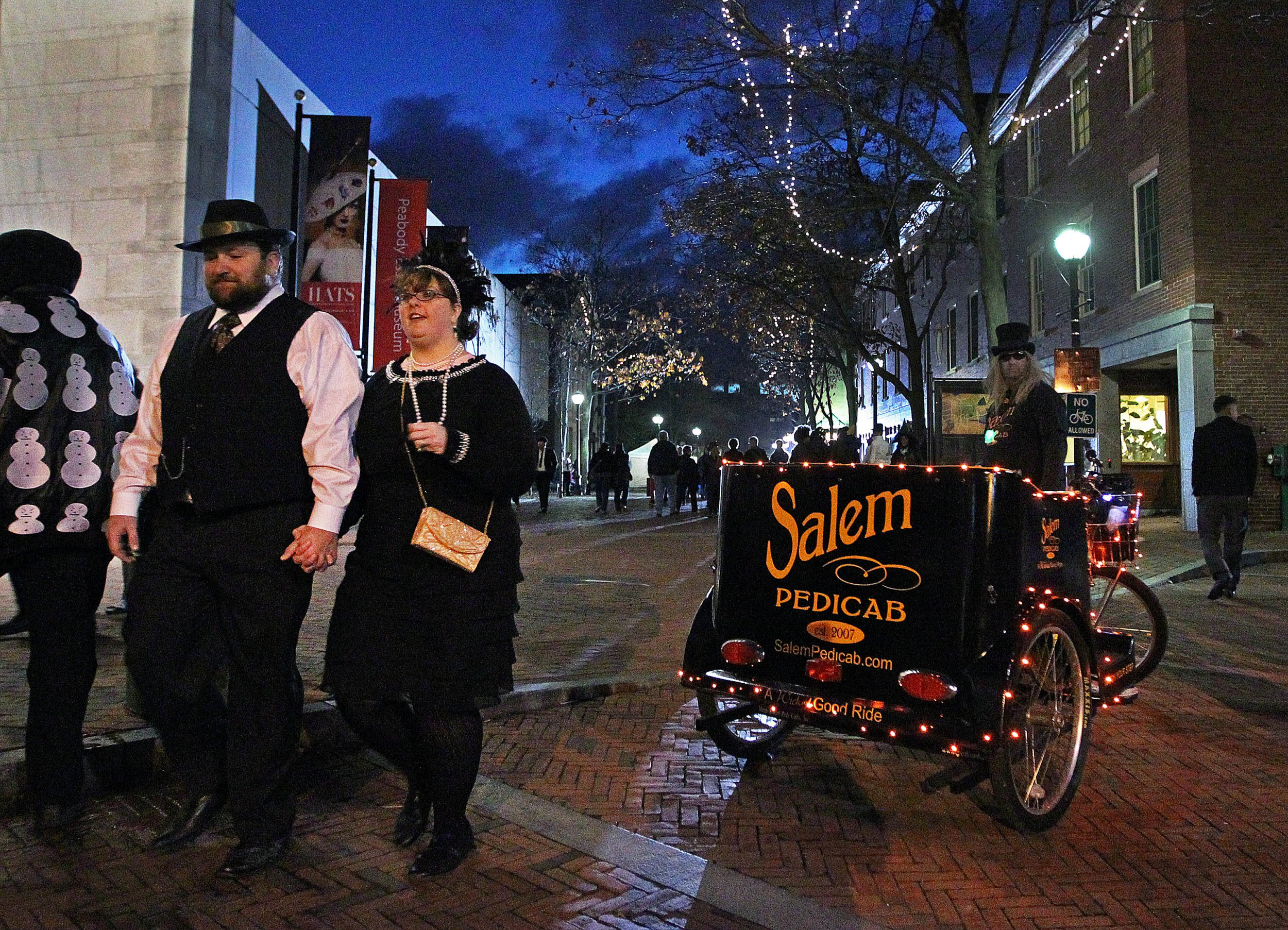 SALEM, MA - OCTOBER 31: The scene on Halloween evening in downtown Salem included revelers as well as businessmen offering pedicab rides. (Photo by Jim Davis/The Boston Globe via Getty Images)