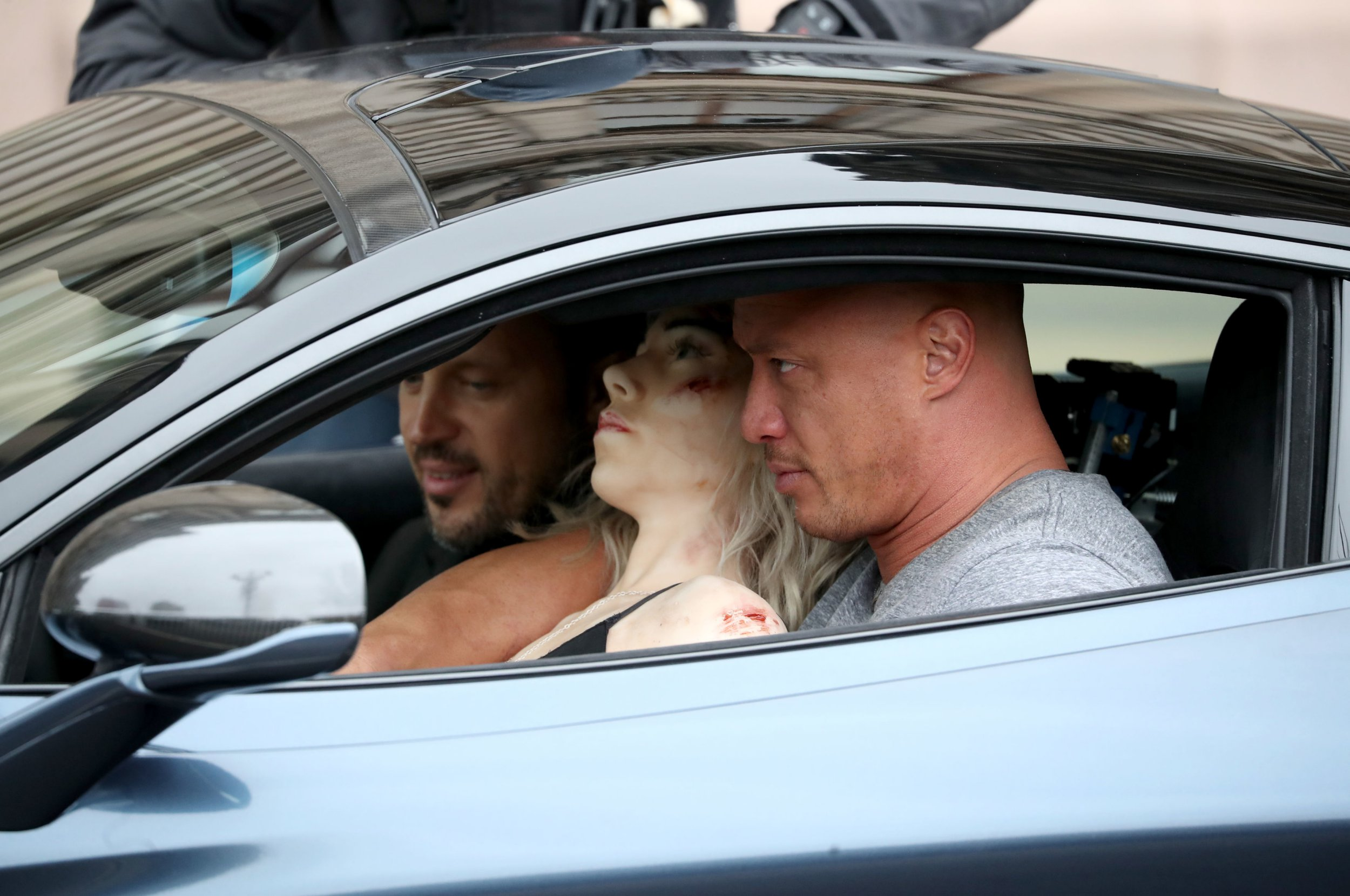 A stunt-double for actor 'The Rock' sits inside a McLaren sports car with a dummy, during filming in Glasgow city centre for a new Fast and Furious franchise movie. PRESS ASSOCIATION Photo. Picture date: Wednesday October 24, 2018. Photo credit should read: Jane Barlow/PA Wire
