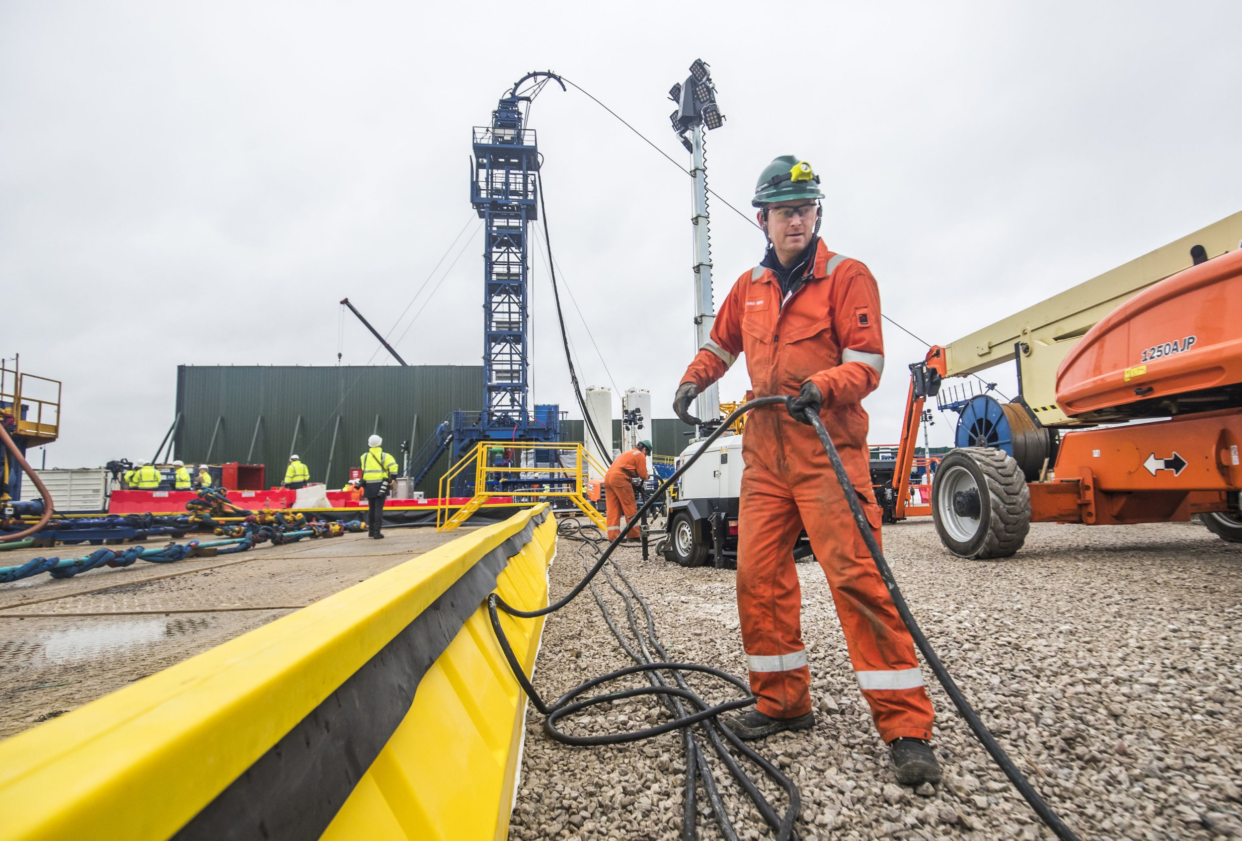 File photo dated 05/10/18 of a worker at the Cuadrilla fracking site in Preston New Road, Little Plumpton, Lancashire. Cuadrilla has confirmed it will continue fracking at the site despite a further tremor being detected underground. PRESS ASSOCIATION Photo. Issue date: Wednesday October 24, 2018. See PA story ENVIRONMENT Fracking. Photo credit should read: Danny Lawson/PA Wire