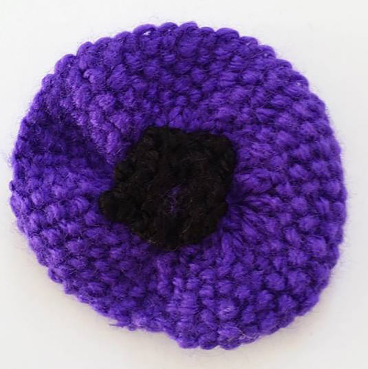 PURPLE POPPIES AND REMEMBRANCE MERCHANDISEWe?re delighted to announce that this years? purple poppies will go on sale on the 1st September. And to mark this special 100th Anniversary year we?ve introduced a brand new range of products too. Do take a look below! PURPLE POPPIESOur traditional purple poppies have been hand made for us by our amazing team of volunteers. They?re priced at just ?3 each which includes postage and packing. You can choose from the ?human? version with pin back, or the specially designed animal version which has an adjustable Velcro fastening to fit safely and comfortably on collars or leads. Poppies are approximately 5 cm in diameter.Numbers are limited, and poppies have sold out in previous years so please order as early as possible to avoid disappointment.Please note every one of these poppies has been hand made with love. Each will be slightly different ? some will be knitted, some crocheted, and there will be variations in colour. If you have a preference as to knitted or crocheted please let us know when you order and we?ll do our best to oblige, but, as we hope you understand, this can?t be guaranteed.