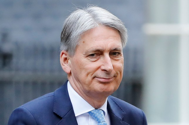 Britain's Chancellor of the Exchequer Philip Hammond arrives in Downing Street in London on October 24, 2018. (Photo by Tolga AKMEN / AFP) (Photo credit should read TOLGA AKMEN/AFP/Getty Images)