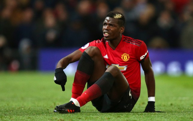 Manchester United's Paul Pogba points to his foot after a foul during the English Premier League soccer match between Manchester United and Everton FC at Old Trafford in Manchester, England, Sunday Oct. 28, 2018. (AP Photo/Dave Thompson)