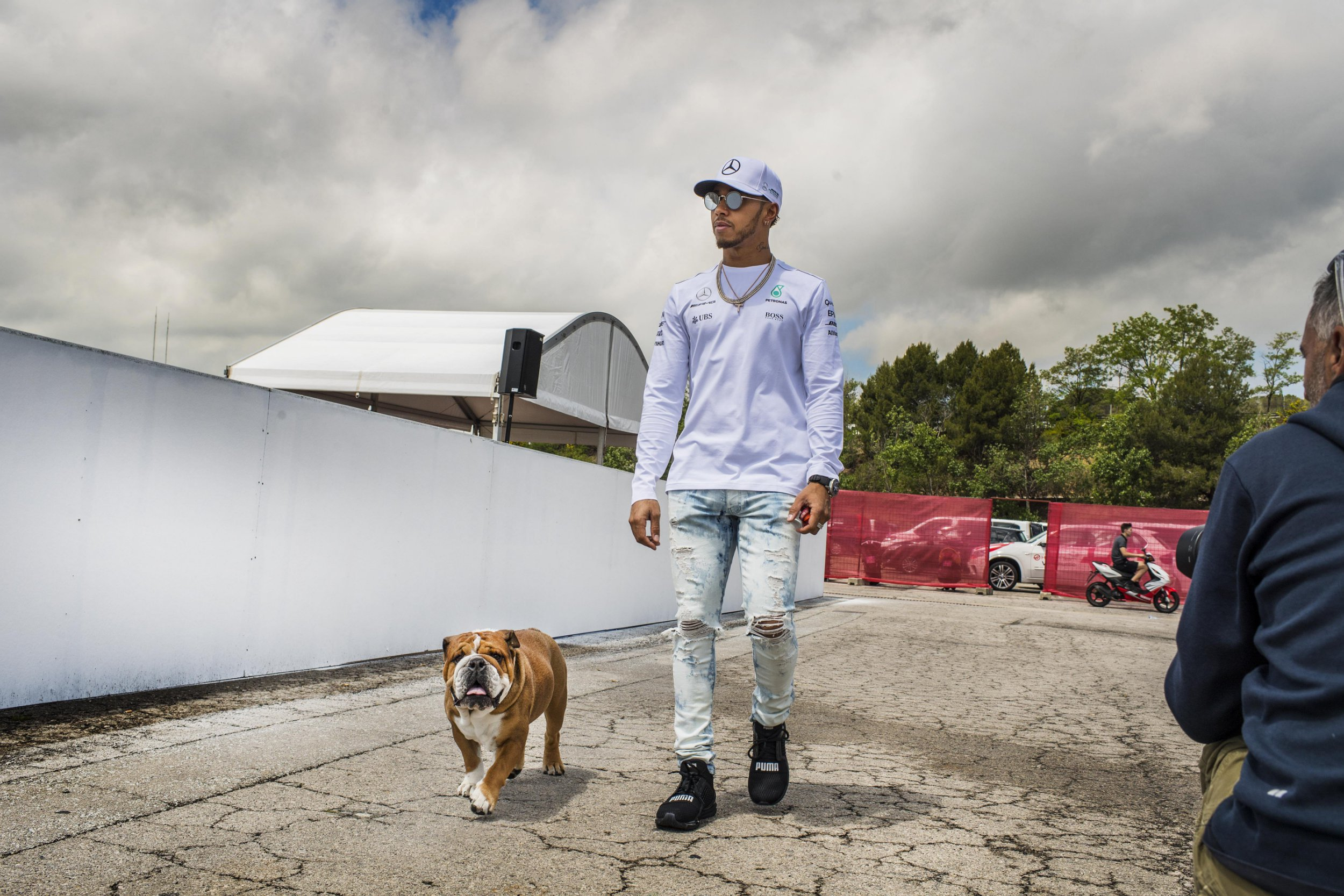 Mandatory Credit: Photo by IBL/REX/Shutterstock (8821724h) Lewis Hamilton and his dog Roscoe Spanish Grand Prix, Preparations, Barcelona, Spain - 11 May 2017