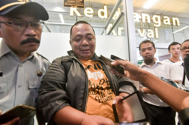 Sony Setiawan (C) speaks to journalists at Pangkal Pinang airport in Bangka Belitung province on October 29, 2018, following his arrival on another airline after missing his pre-planned flight on Lion Air flight JT 610 which crashed off the coast north of Jakarta. - Setiawan was due to board the ill-fated Boeing-737 MAX but was held up on his commute to Soekarno-Hatta airport by Jakartas notorious traffic congestion. The brand new Indonesian Lion Air plane carrying 189 passengers and crew crashed into the sea on October 29, officials said, moments after it had asked to be allowed to return to Jakarta. (Photo by RONI BAYU / AFP)RONI BAYU/AFP/Getty Images