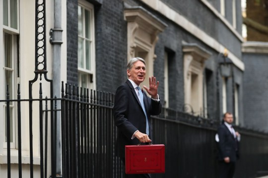 British Chancellor of the Exchequer Philip Hammond poses for pictures with the Budget Box as he leaves 11 Downing Street in London, on October 29, 2018, before presenting the government's annual Autumn budget to Parliament. - Chancellor of the Exchequer, Hammond will try to navigate a political minefield when he unveils a budget that could be scuppered by the final terms of Brexit next year. (Photo by Daniel LEAL-OLIVAS / AFP)DANIEL LEAL-OLIVAS/AFP/Getty Images
