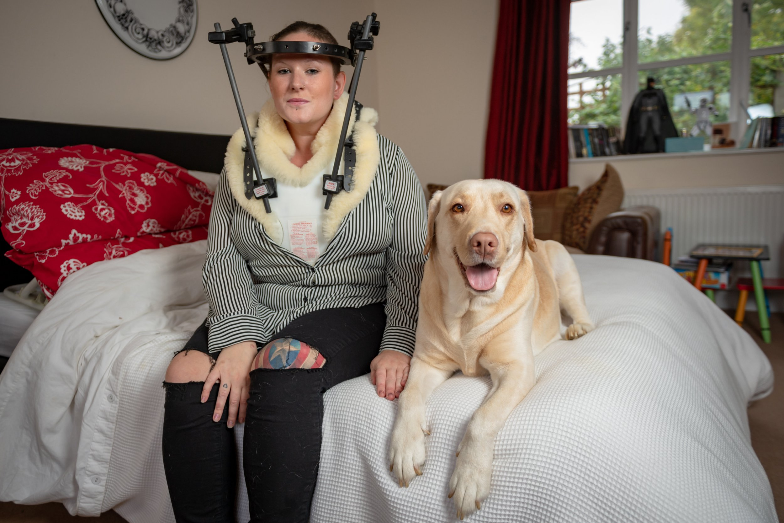 Bexx Hunt age 28 with her Golden Labrador Tequila age 5. See SWNS Cambridge copy SWCAfall:A mum was almost paralysed after tripping over her dog and falling down the stairs in a freak accident.Bexx Hunt (corr), 28, broke one of the vertebrae in her neck after tumbling over golden Labrador Tequila when she got up in the night to use the loo.She was told by doctors that if the break had been in a different bone, she would have been left paralysed.